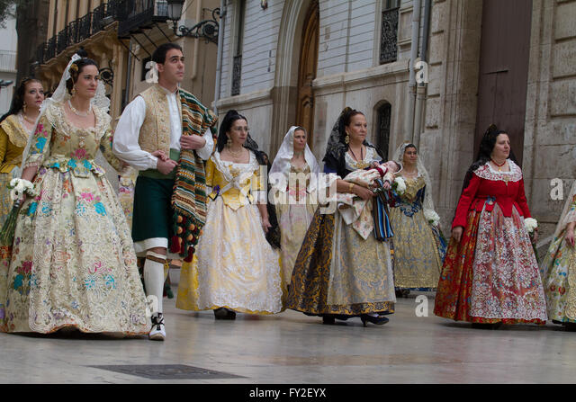 Flower offering procession in honour of the Lady of the Forsaken during Las Fallas Festival  Valencia Spain - Stock Image