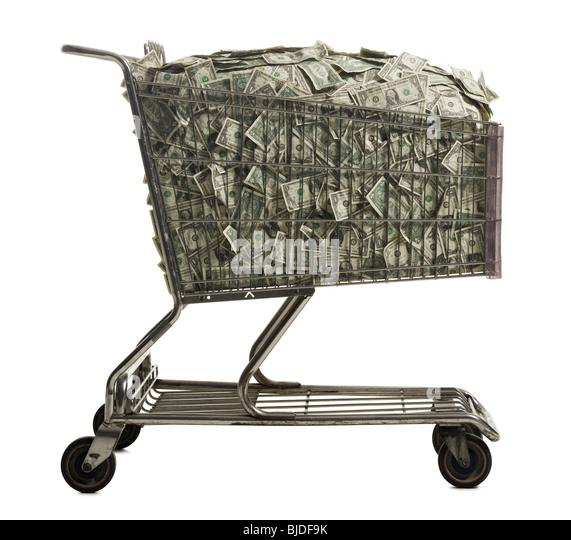 Shopping cart full of American dollars. - Stock Image