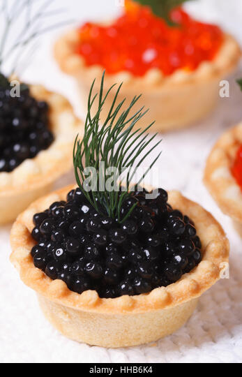 Canapes with black caviar stock photos canapes with for Black caviar fish