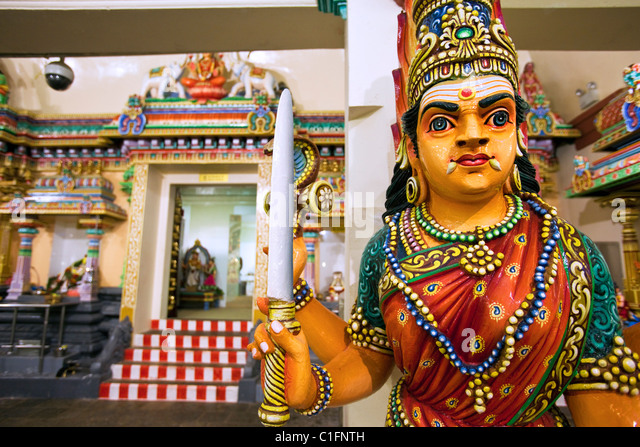 Hindu guardian at the Sri Mariamman Temple.  Chinatown, Singapore - Stock Image