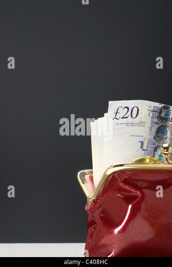 Purse with pound notes in it - Stock Image
