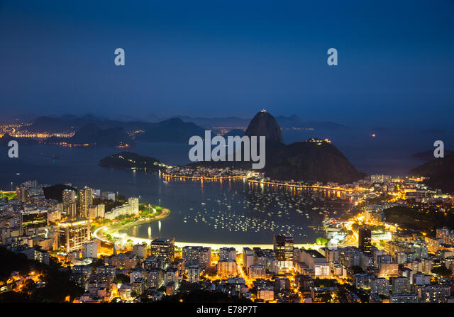 the bay, city and Sugar Loaf Mountain at dusk, Rio de Janeiro, Brazil - Stock Image