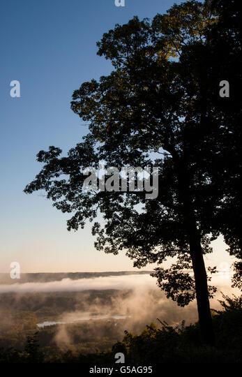Fog Rising Over Mississippi River at Wyalusing Park - Stock Image