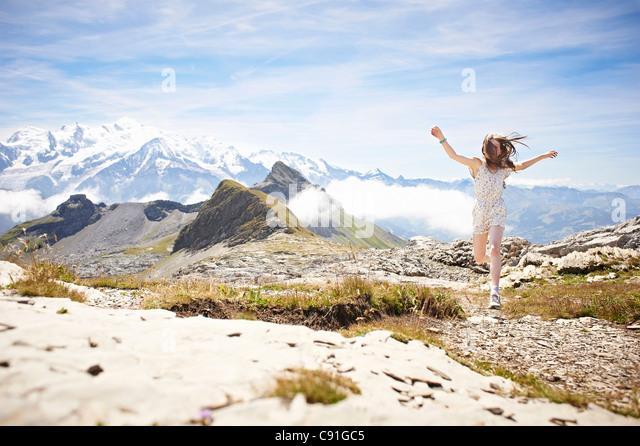 Girl walking in rocky landscape - Stock Image