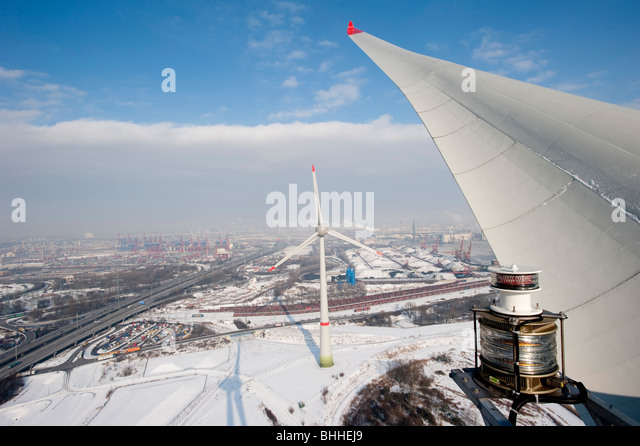 Germany Hamburg - Enercon wind turbine E-126 with 6 MW in harbour and view on Hamburg City - Stock Image