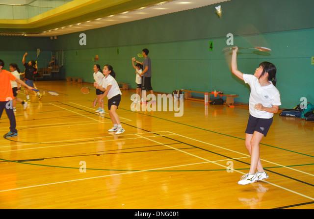 Hong Kong China Island Central Hong Kong Park Sports Centre center badminton courts indoor gymnasium Asian girl - Stock Image
