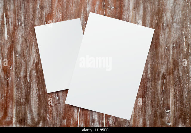 Closeup Two Blank White Paper Sheet Mockup Natural Wood Table Background. Empty Canvas Painted Brown Desk - Stock Image
