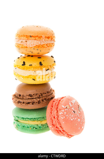 A stack of multi-coloured macaroons - studio shot with a white background - Stock Image
