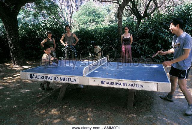 Park people playing table tennis Barcelona Spain Europe Nikos Kokkas IML Image Group Local Caption  - Stock Image