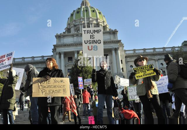 Harrisburg, Pennsylvania, United states. 19th Dec, 2016. Protesters gather at the State Capitol steps in anticipation - Stock Image