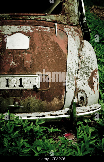 Discarded car in nature - Stock Image