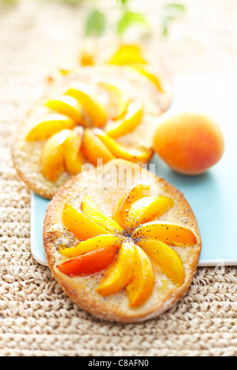 Peach and apricot pizzas - Stock Image