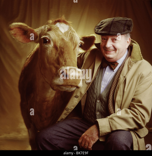 portrait of man with cow - Stock Image