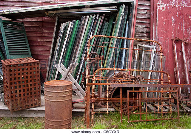 Salvage yard in rural Maine. - Stock Image