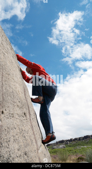 rock climber bouldering at Burbage Edge South, Derbyshire, Peak District National Park, England, UK, United, Kingdom, - Stock Image
