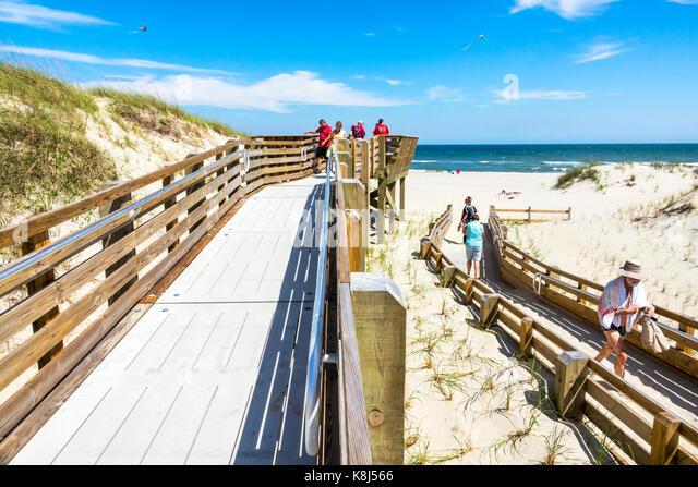 North Carolina NC Outer Banks Atlantic Ocean Ocracoke Island Cape Hatteras National Seashore boardwalk beach sand - Stock Image