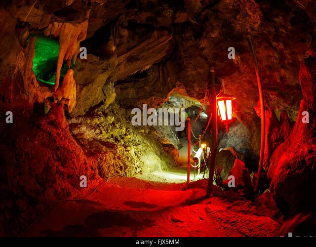 Illuminated Lantern In Cave - Stock Image