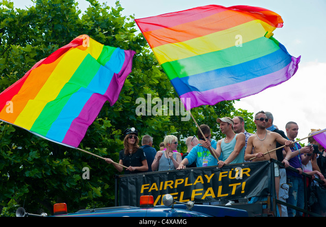 People on float waving flags at Christopher Street Day Parade in Berlin Germany 2011 - Stock Image