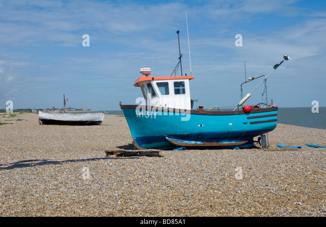 Small boat on shingle beach stock photos small boat on for How to not get seasick on a fishing boat