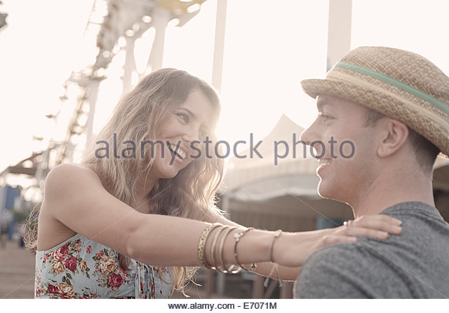 Young couple laughing on Santa Monica pier, California, USA - Stock Image