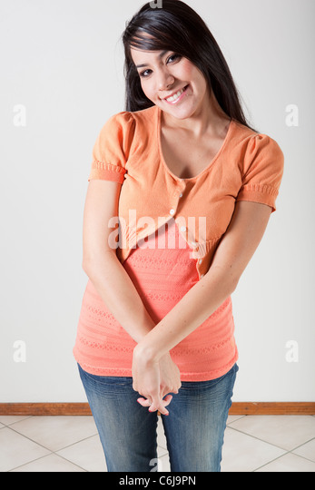 Bashful Hispanic Woman Smiling - Stock Image