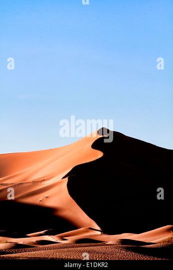Erg Chebbi sand dunes in the Sahara desert near Merzouga, Morocco - Stock Image