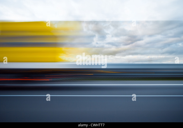 blurred motion,on the move,lawn,driving - Stock Image