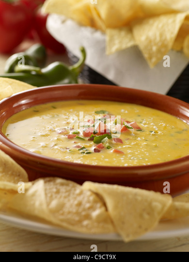 Queso cheese dip with chips - Stock Image