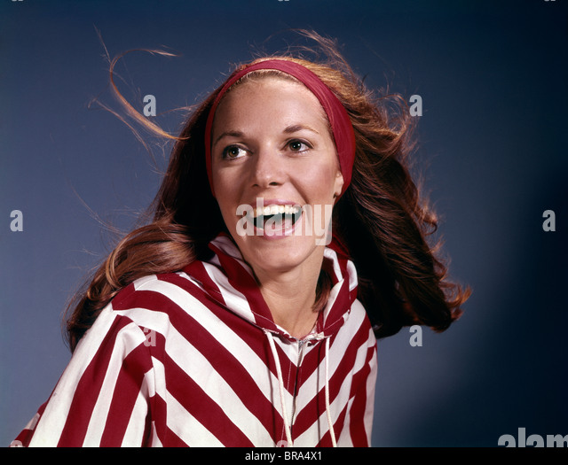 1960s PORTRAIT SMILING LAUGHING WOMAN RED HEADBAND STRIPED JACKET FASHION RETRO - Stock Image