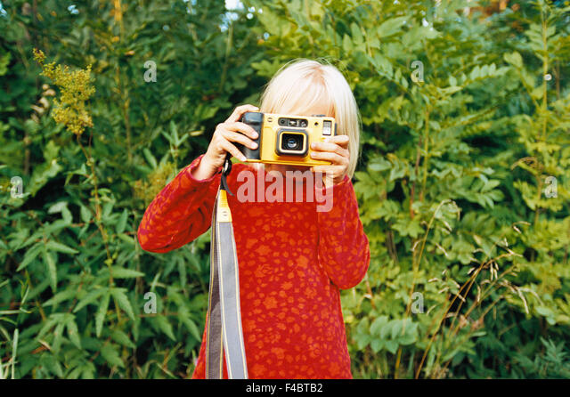 camera children only color image elementary age girls horizontal one person only outdoors portrait summer waist - Stock-Bilder