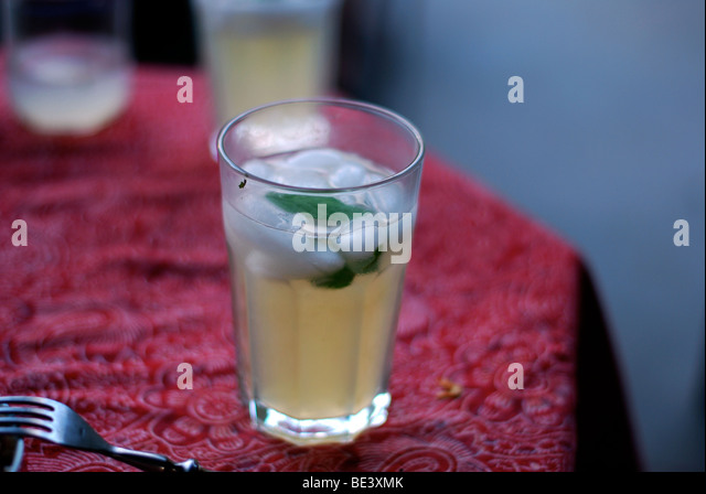 Glass of Mojito on red table cloth - Stock Image