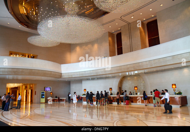 China Hong Kong Island Fortress Hill Harbour Grand Hong Kong hotel lobby inside interior chandelier front desk check - Stock Image