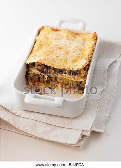 Aubergine and chicken lasagne in a roasting dish - Stock Image