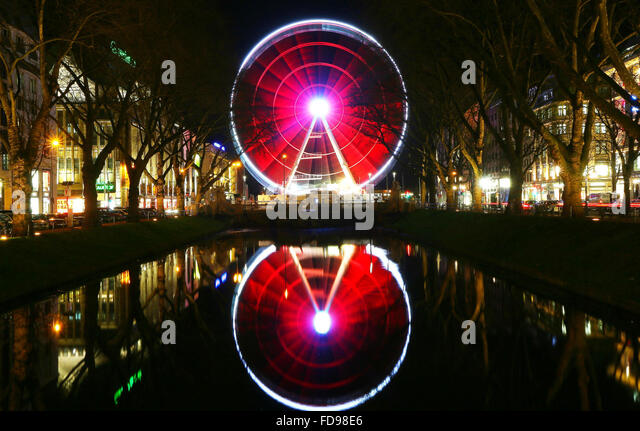 Duesseldorf, Germany. 28th Jan, 2016. The illuminated ferrys wheel 'Wheel of Vision' spins in Duesseldorf, - Stock Image