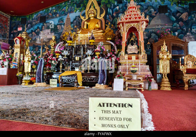 Florida Orlando Kissimmee Wat Florida Dhammaram Buddhist Monastery temple inside altar mat reserved monks only - Stock Image