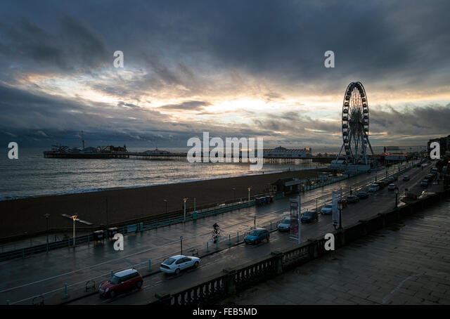 After the rain storm: Brighton seafront with the wheel and Brighton Pier - Stock Image