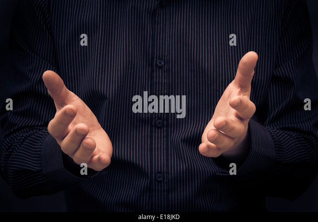 Man gesturing during a speech or showing something - Stock Image