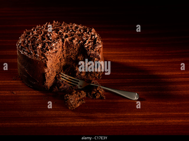 Luscious dark chocolate cake on a retro style background - Stock Image
