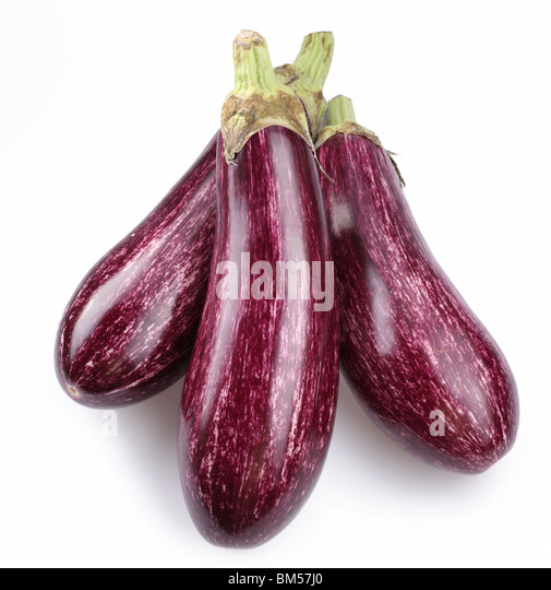 Purple eggplants with leaves on white background - Stock Image