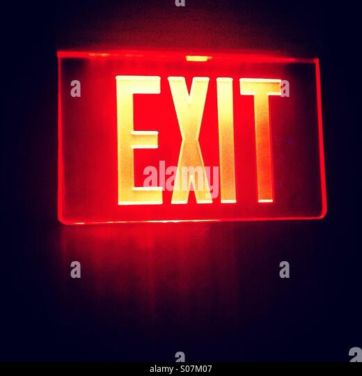 Red exit glowing sign - Stock-Bilder