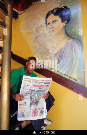 Curaçao Netherlands Antilles Dutch Willemstad Punda Wilhelmina Plein Cafe waiter Papiamento Papiamentu language - Stock Image