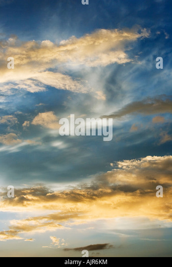 Sunset storm clouds in India. Indian cloudy sky in the evening sunlight - Stock-Bilder
