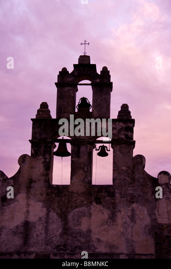 Mission San Juan Capistrano bell tower San Antonio Texas tx dramatic purple sky silhouette - Stock Image