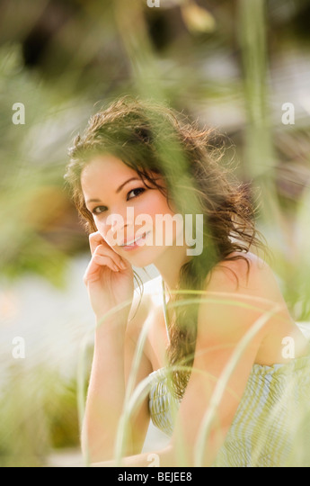 Portrait of a young woman day dreaming - Stock-Bilder