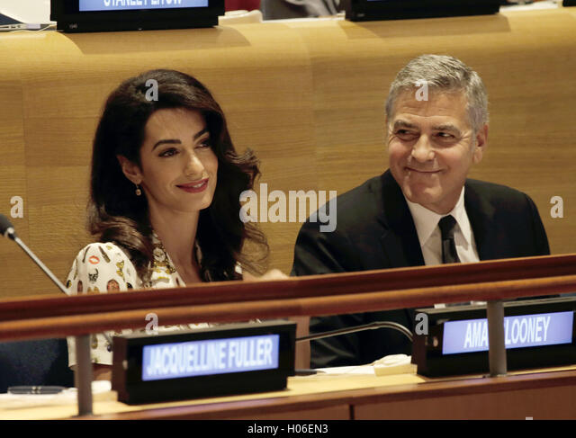 New York, New York, USA. 20th Sep, 2016. United States actor George Clooney (R) and wife Amal Clooney attend a Leaders - Stock-Bilder