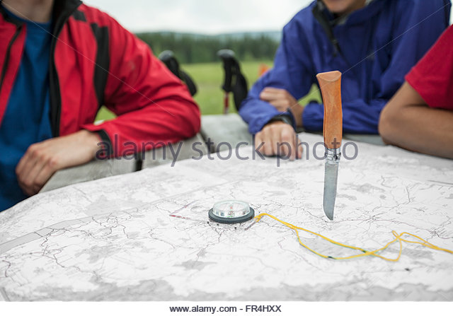 hikers determining their destination with random knife throw - Stock-Bilder