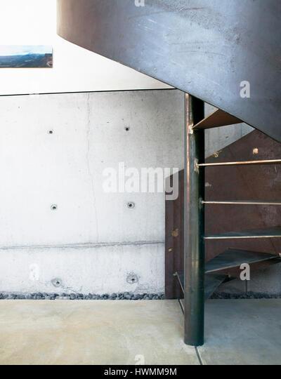 Interior steel staircase in the ground floor studio. Xeros House, Phoenix, United States. Architect: Blank Studio, - Stock-Bilder