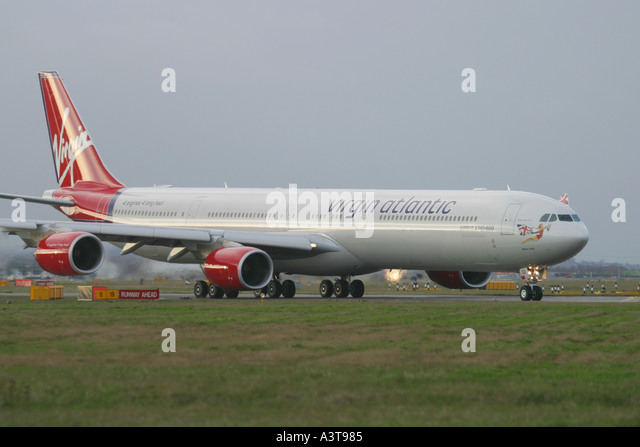 Commercial aircraft Airbus A340 642 Virgin Atlantic Airways preparing for departure at London Heathrow Airport - Stock Image