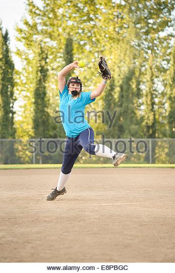 Girl (13-15) playing baseball - Stock Image