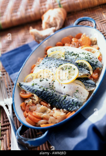 Mackerel in casserole dish with vegetables, close-up - Stock Image